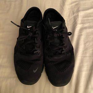 Women Nike free all black sneakers